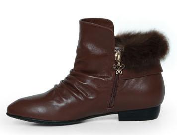 真皮女鞋网店代理一件代发纯色扣饰女靴